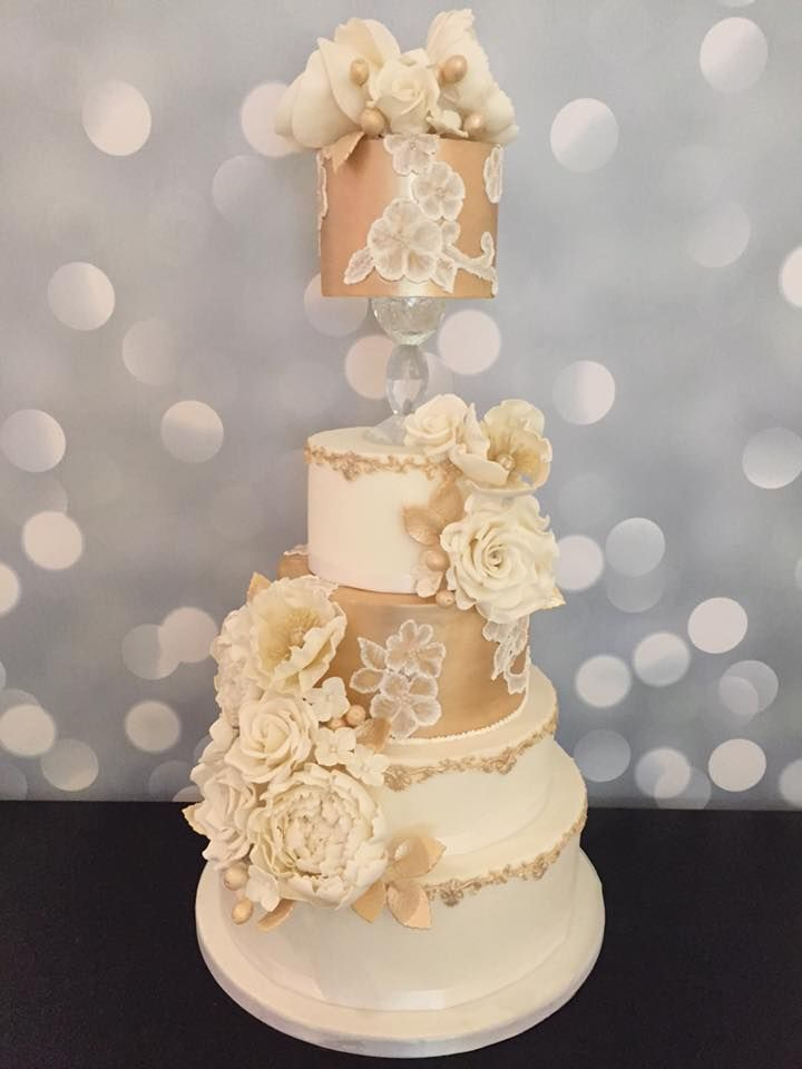 Gold and ivory floating tier wedding cake with