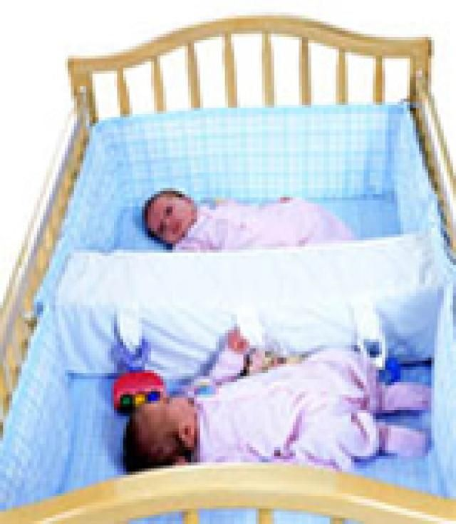 Parents of twins and multiples seeking twin cribs for their babies will find information about cribs for twins in this slideshow featuring pictures of twin cribs.: Crib Divider