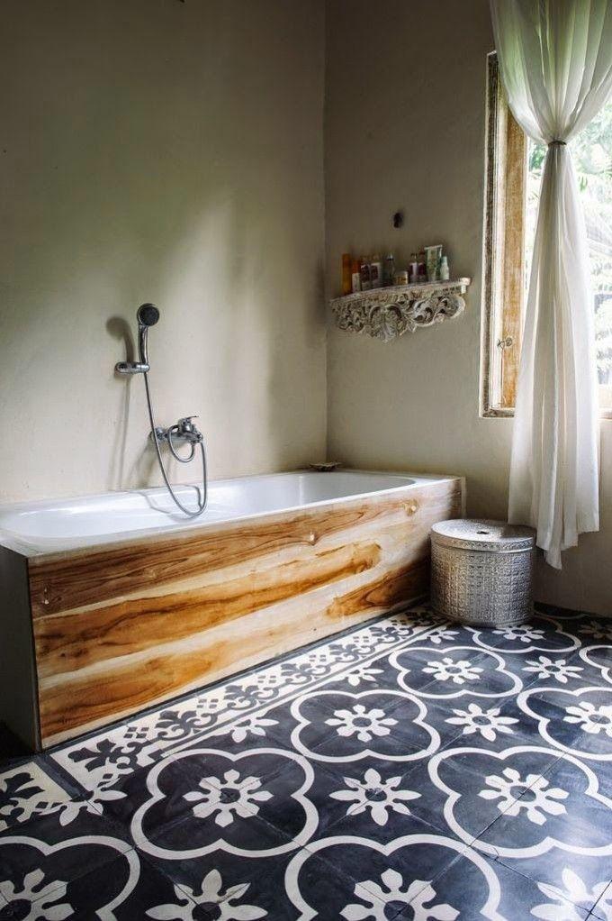 blue patterned tiles or the wood-framed bath tub