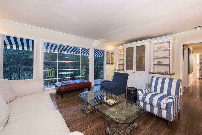 Elegant Hollywood Hills Spanish c. 1946. This Mediterranean beauty sits poised to enjoy views from every room. Features include a gracious formal living and dining room, an extensively remodeled cook's kitchen, a spacious master suite starring a relaxing bath with enviable views, steam shower...