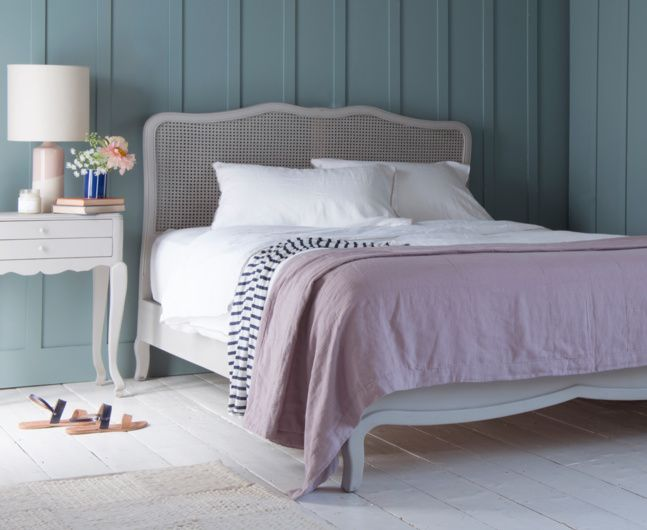 Our Margot bed is handmade from solid oak and is now available in our vintage-style painted grey finish. We love its French style rattan headboard worthy of a boutique-hotel bedroom.