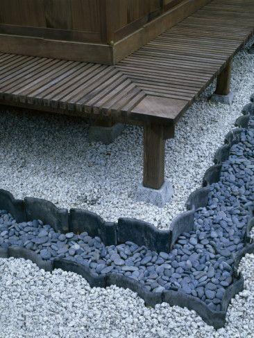 zen garden- use different edging + pea gravel & river rock