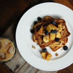 Classic French toast with cinnamon-roasted pineapple, blueberries, and ...