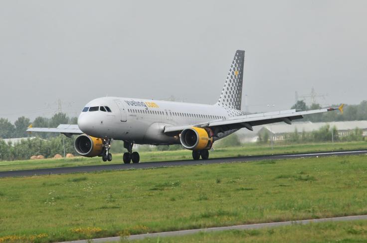 Veuling.Com Airbus A320 landing @ Schiphol Airport