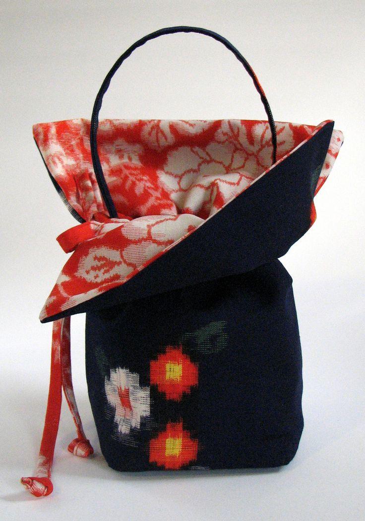 Kinchaku style handbag made from vintage Japanese wool kasuri kimono fabric.