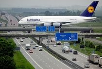Airbus A crossing the Autobahn at Leipzig airport