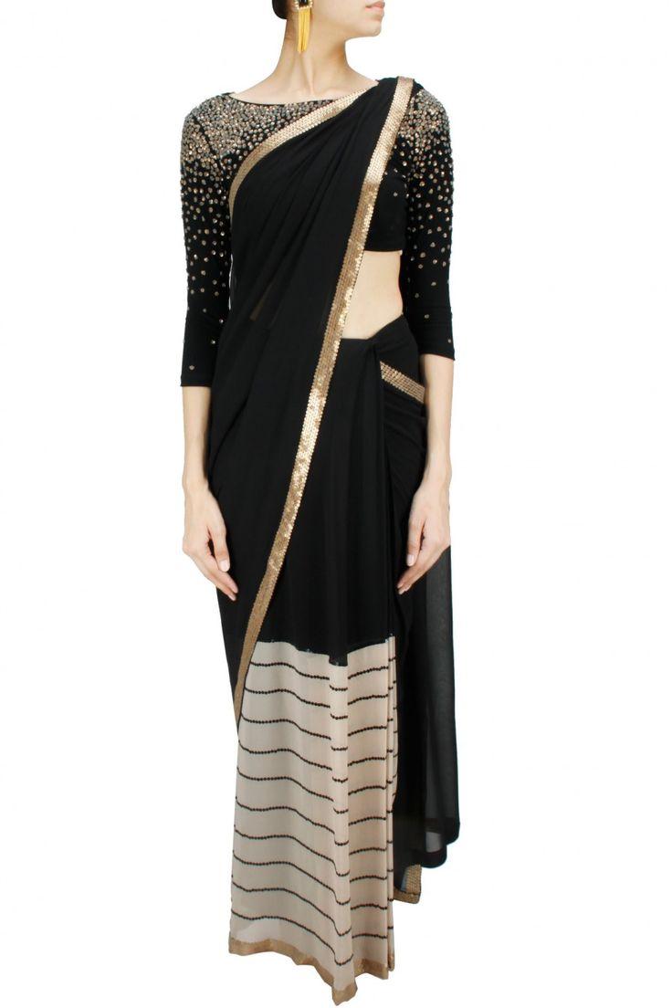 Black silk and striped georgette sari with sequin embellished blouse. BY NAMRATA JOSHIPURA. Shop now at: www.perniaspopups... #perniaspopupshop #designer #stunning #fashion #style #beautiful #happyshopping #love #updates