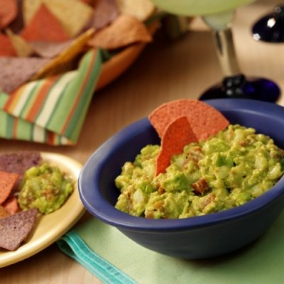 Easy guacamole recipe 'rocks' with zesty Ro*Tel tomatoes, onion and lime juice added to creamy mashed avocados