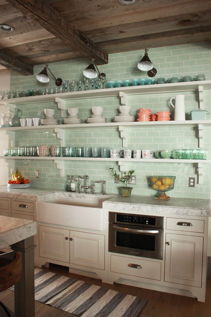 minty subway tile / rustic ceiling / white cabinets / open shelves / farmhouse sink