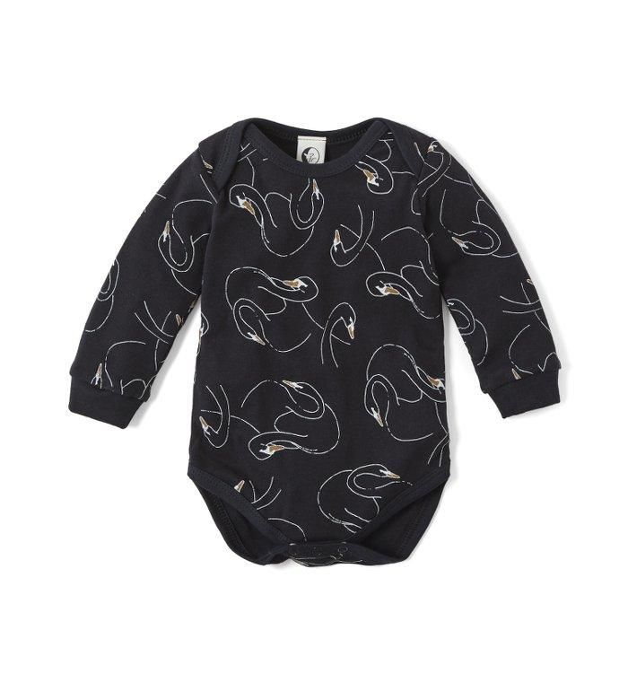 The softest baby vest in our Swansy Noir print is an ideal gift for any new baby. The envelope neck makes it easier to wear and the poppers are easy to fasten. A great layering piece at night or teamed with some leggings for daywear. Matching kids PJs and mumma set available. 100% cotton jersey, a very soft interlock fabric for maximum night-time comfort. Knitted, printed and made ethically in the U.K. in a small family run factory. Product should have no more than 5% shrinkage after a few…