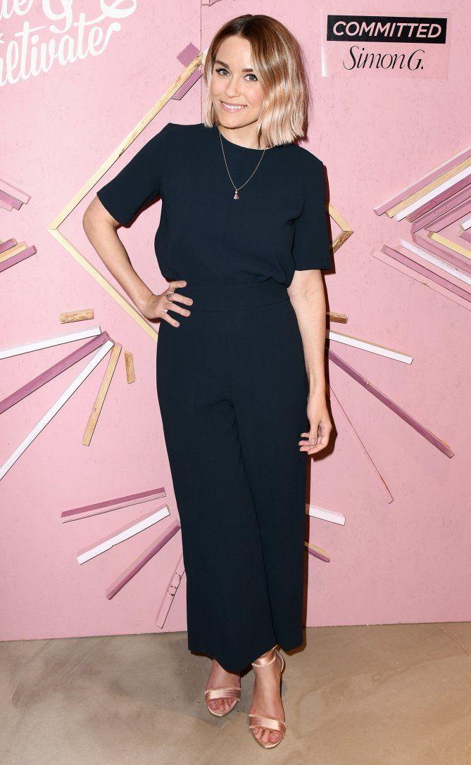Lauren Conrad in a black wide-leg jumpsuit