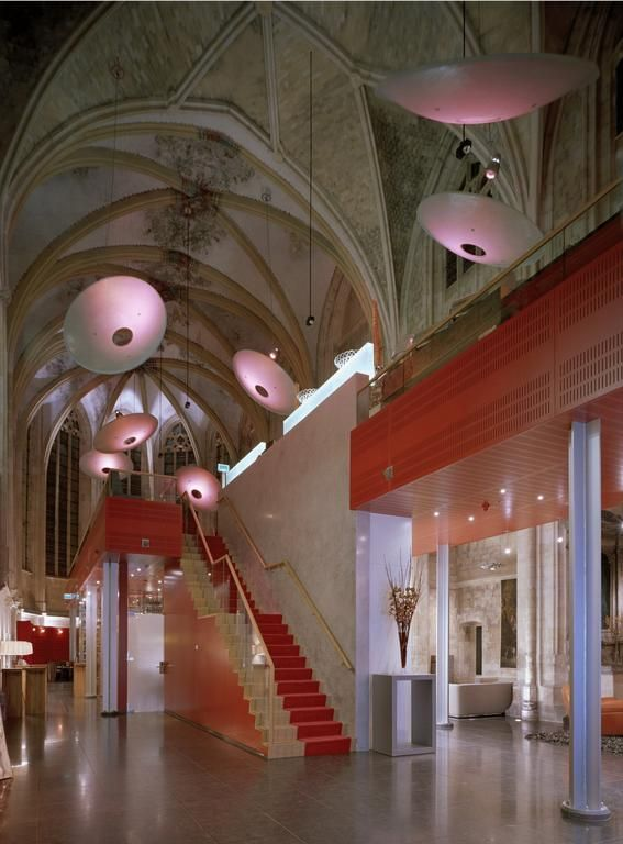 Admire the stunning interiors of a renovated Gothic monastery... The unusual Kruisherenhotel Maastricht combines the medieval outside with spectacular designer furnishings.
