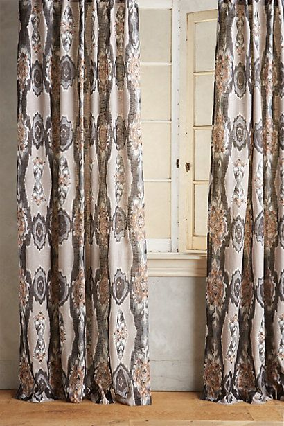 Stretched Ikat Curtain #anthropologie  This is available in a blue color that I really like.  Obviously we'd have to make them ourselves for it to be in the budget, but the print and colors are nice.