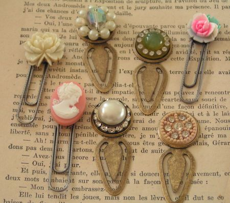 I had gotten these clips a few years ago at a scrapbook store, but I'm sure they're still available. Just a dab of hot glue from your glue gun or E6000 and you've got a pretty little clip for bookmarks!