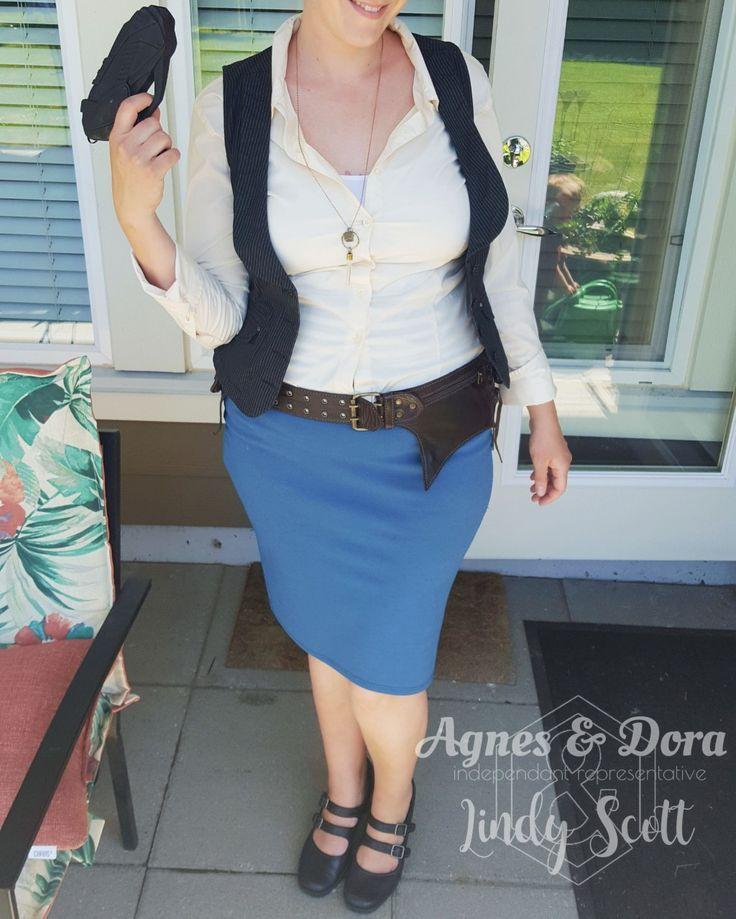 Female Han Solo Cosplay costume. Agnes & Dora pencil skirt, cream shirt, vest and belt.