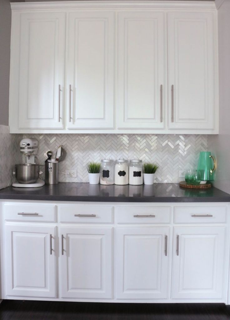 I love the herringbone and the white cabinets and the pops of teal.