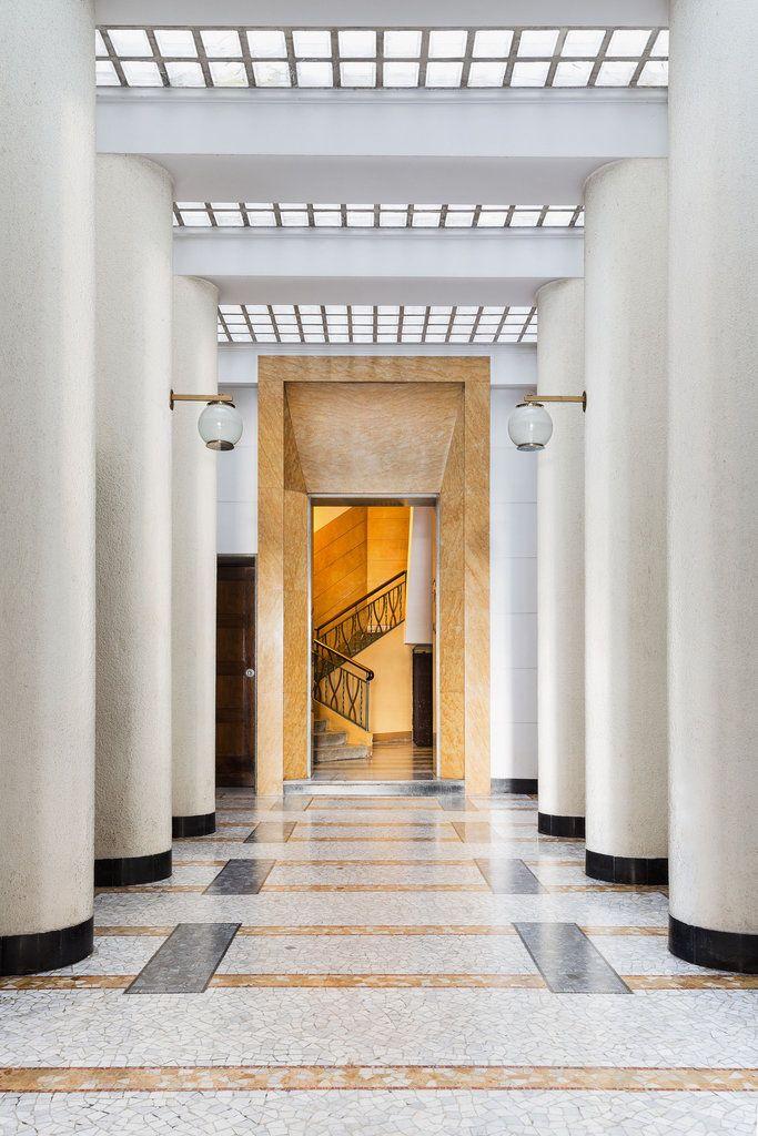 Floor: Palladiana of Giallo Siena marble and mosaics, terrazzo