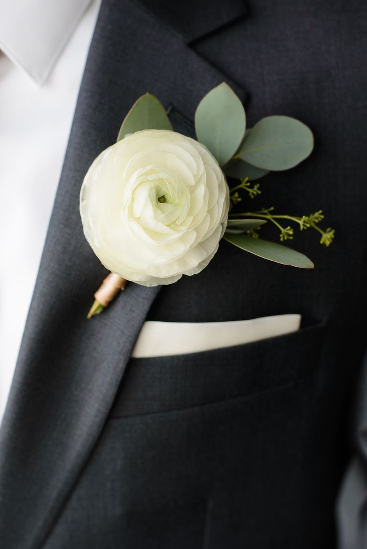 Kristen & Ryan | Wedding in Tampa Bay | White Ranunculus and Seeded Eucalyptus boutonniere. #andrealaynefloraldesign #tampaweddings