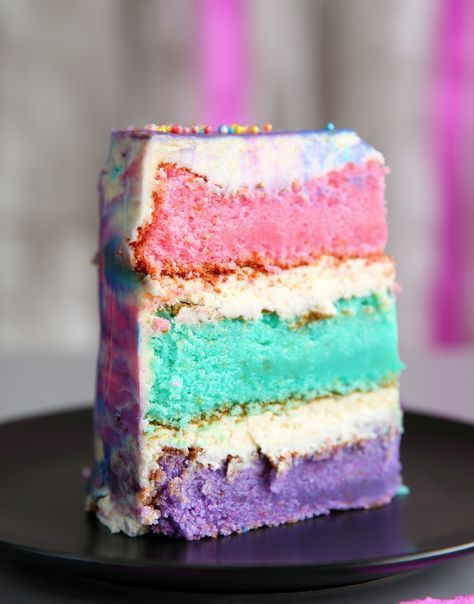Beautiful pink, teal, and purple layer cake- perfect for a magical Shimmer and Shine birthday party!