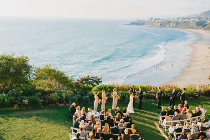 We love a classic beach wedding filled with love.  Lindsey & Michael's love story begins When a girl from Orange County hit the Big Apple, Lindsey probably wasn't expecting to fall in love with a boy from New Zealand. And what better location to get married but on the California coast, half way between New Zealand and New York, bringing together their world-wide loved ones. Wedding dress by Sarah Jassir.