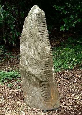 Ogham stone from Co. Kerry, Ireland.  Ogham is known to be the earliest form of written language in Ireland.  It dates from the 4th Century AD and was used over a period of about 500 years.  The marks are read from the left, bottom up then down the right.  The stones commemorate someone or an event.