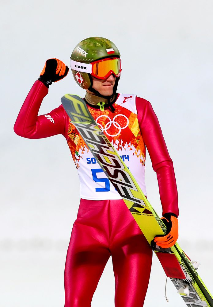 SOCHI, RUSSIA - FEBRUARY 15: Gold medalist Kamil Stoch of Poland celebrates after the Men's Large Hill Individual Final Round on day 8 of the Sochi 2014 Winter Olympics at the RusSki Gorki Ski Jumping Center on February 15, 2014 in Sochi, Russia. (Photo by Alexander Hassenstein/Getty Images)