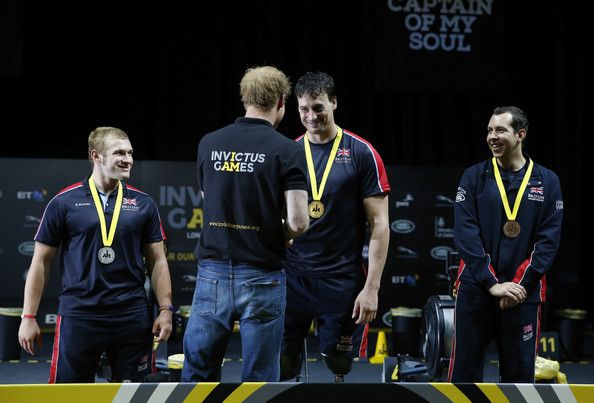 Prince Harry Photos Photos - Nick Beighton of Great Britain is presented with his gold medal by Prince Harry after competing in the IV4 sprint indoor rowing at Olympic Park on September 13, 2014 in London, England. Photo: - Invictus Games - Day Three - Indoor Rowing
