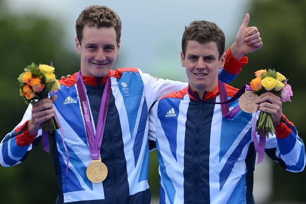 Alistair and Jonny Brownlee show off their medals