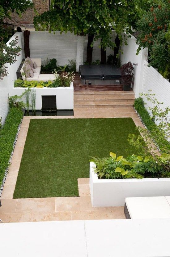 Perfect small garden back yard with a hot tub! Green, white and black!
