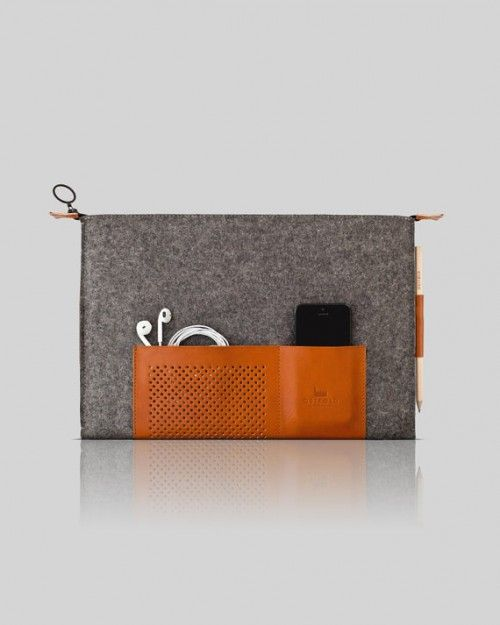 Macbook Case is a minimal design created by France-based designer Ostfold. Ostfold is a French studio that offers a range of premium wool & leather cases for various technological devices of the 21st century (Apple and Samsung). Designed in Paris, Ostfold takes its inspiration from the Scandinavian minimalism of the 50's and 60's which embodies simplicity and functionality. The design is based on an iconic perforation pattern obtainedthrough the use of a 60 ton press. (6)