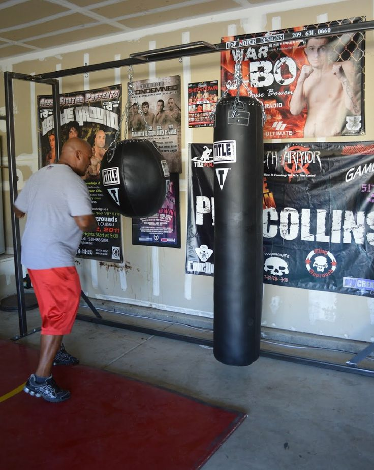 Custom built heavy bag stand for phil the pain collins