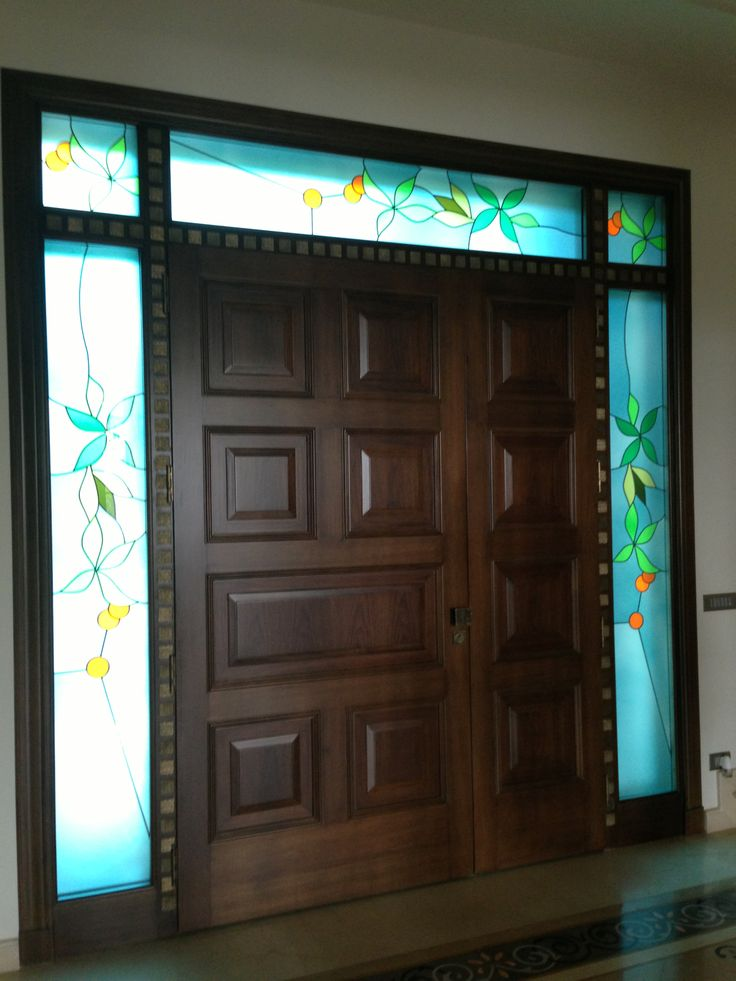 Entrance door - Wooden raised panels and special artistic glasses