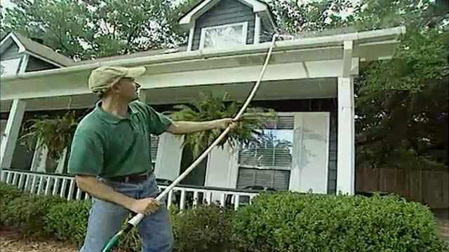 Cleaning gutters | Today's Homeowner