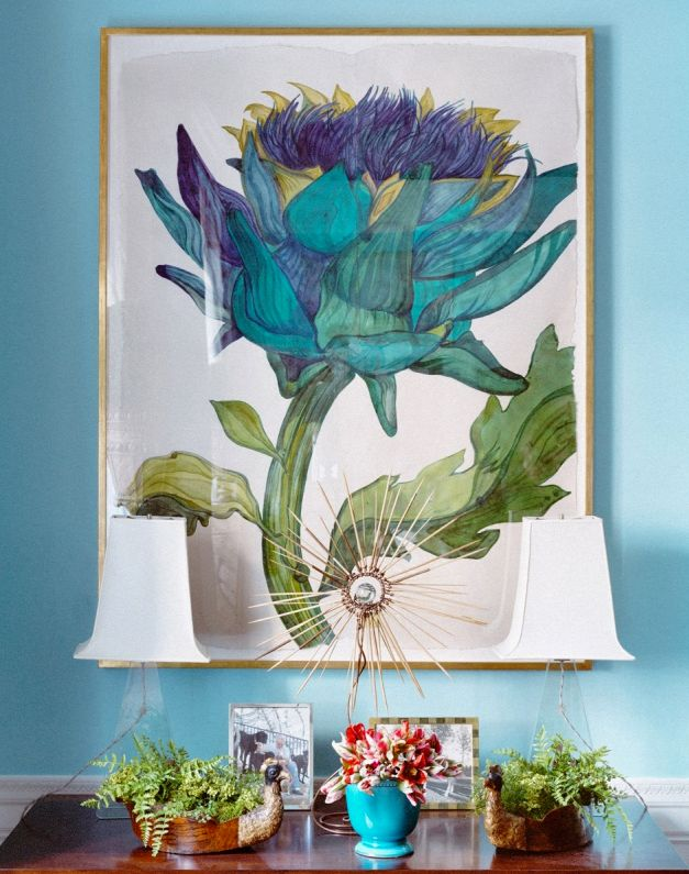 Complement colour with art A beautiful blue vignette unifies this dining room's central colour theme, while working double-duty as the room's focal point.