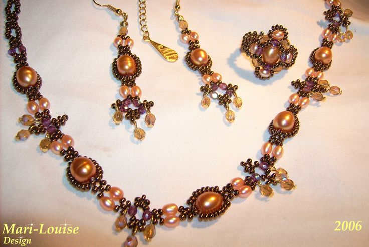 Set of necklace, earrings and ring