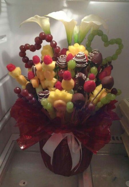 DIY edible arrangement. All you need are flower cookie cutters, skewers, fruit, vase, ribbon and your own creativity.