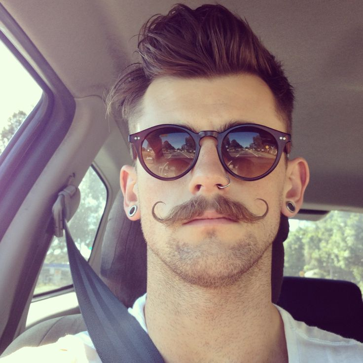 Super Mustache Style- too bad about the nose piercing but the hair and facial hair are amazing. And the sun glasses I like them too.: