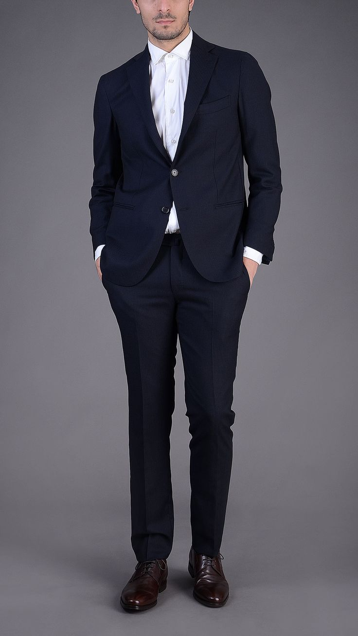 Pinstripe three button single breasted blazer with matching four pockets classic trousers. 60% viscose 40% cupro.