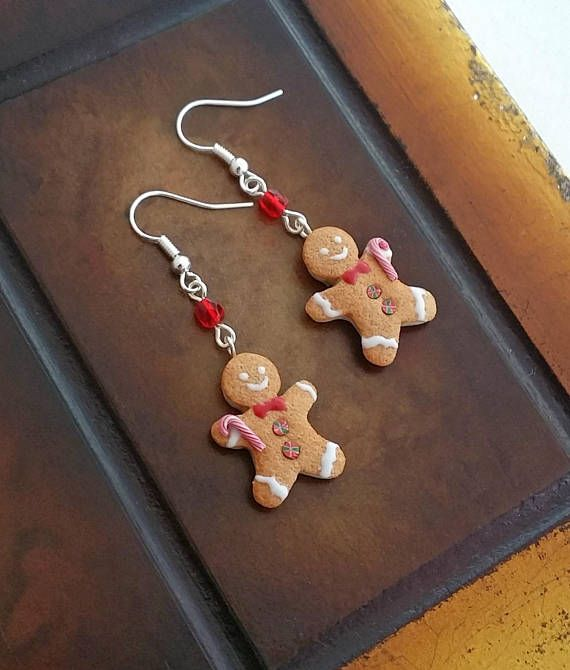 Gingerbread man holding peppermint stick earrings handmade