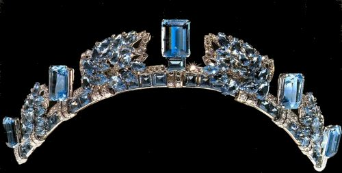 The Aquamarine Pine Flower Tiara was commissioned by HM King George VI from Cartier as a wedding anniversary gift for his wife HM Queen Elizabeth. It is also known as Princess Anne's Aquamarine Pine Flower Tiara, or HM Queen Elizabeth The Queen Mother's Cartier Aquamarine Tiara. This tiara is composed of aquamarines and diamonds arranged in a pine cone motif (hence the 'pine flower' designation), interspersed with large upright rectangular aquamarines and smaller diamonds.