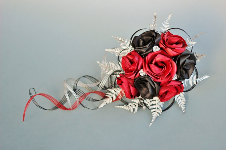 Waterfall bouquet with trailing loops in red and black with silver fern.  www.flaxation.co.nz