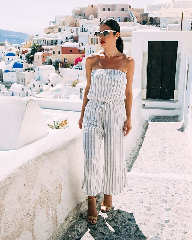 The Bell Jumper by Blue Life features a pretty pastel stripe print throughout, strapless silhouette, cinched waist, and a wide midi length leg.  Made in USADry Clean Only100% RayonFit Guide:Model is 5