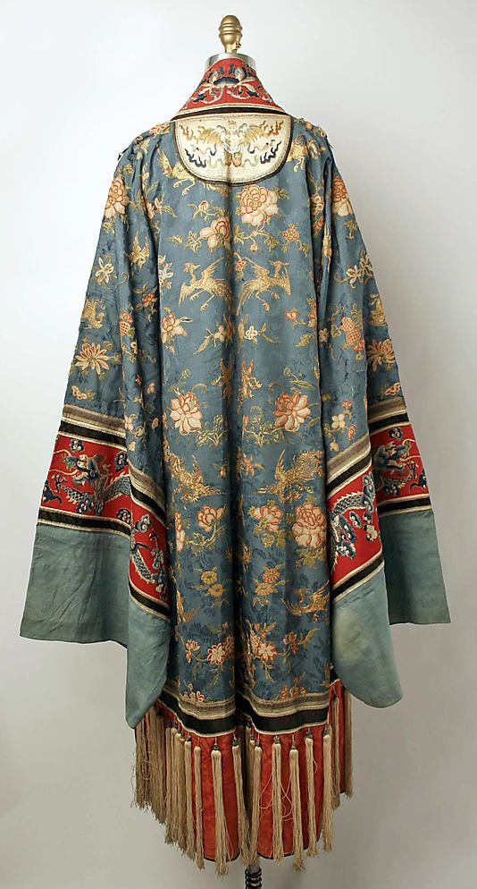 Chinese robe---When I visited Hong Kong I enjoyed the Chinese robe exhibit. The museum was in a wondrous location on the water where one could turn from the art & see a port of every floating vessel from sampan to ocean liner.