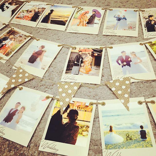 フォトガーランド完成(*^^*) 100均で売ってた麻ガーランドも混ぜて飾ってもらいます☺️ #アニ嫁#2016春婚 #結婚式準備 #プレ花嫁 #フォトガーランド #前撮り #前撮りロケーション