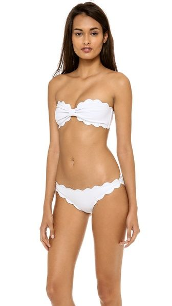 Marysia Swim Antibes Scallop Bikini Top Scalloped edges and gathered cups effect the look of a bow on a Marysia Swim bandeau bikini top. Boned sides. Slide-lock clasp. Unlined. $130