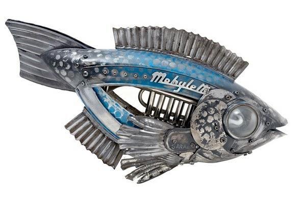 Esculturas de animales hechas con tapacubos de coches