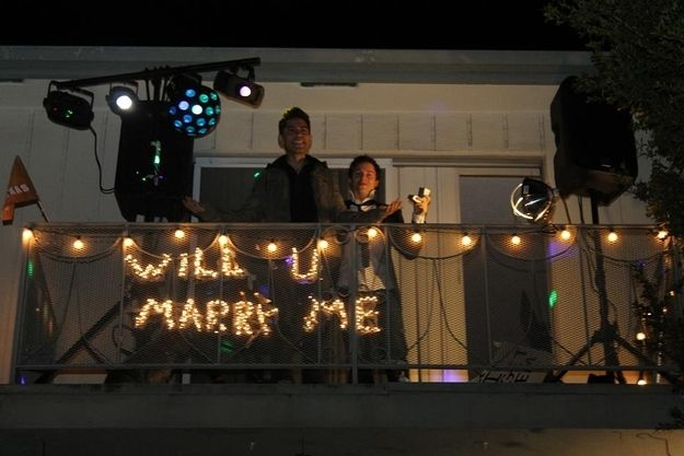 Lucas had the police shut down an entire street while dancers from Step Up performed a choreographed number. As a final touch, the big question was strung out in lights. | High School Bully Apologizes After Seeing Gay Victim's Wedding Proposal Video Online