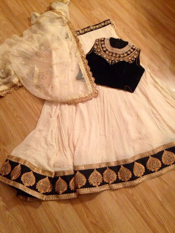 Black high neck blouse and Cream lengha by Kuvira London www.kuviralondon.com #bollywood #outfit #indian #designer