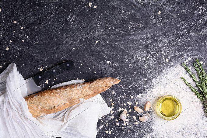 Fresh baguette with rosemary by Iuliia Leonova on @creativemarket