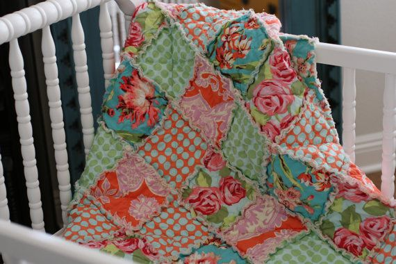 This baby rag quilt is made with patterns from Amy Butlers Love Collection. This bright and cheery pallet of Mint Green, Tangerine Orange,